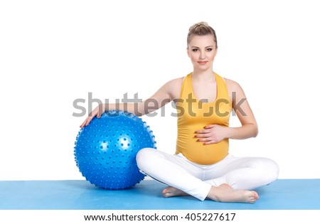 Caucasian young woman exercising yoga for pregnant with blue fitball in studio isolated on white background. Happy blonde pregnant woman exercising on exercise ball. pregnant woman practicing yoga - stock photo