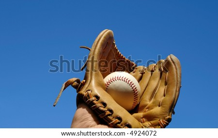 Caught baseball in glove landscape photo. Space at left for messaging. - stock photo