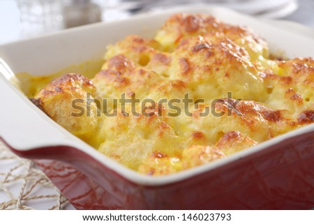 Cauliflower cheese in a baking dish - stock photo