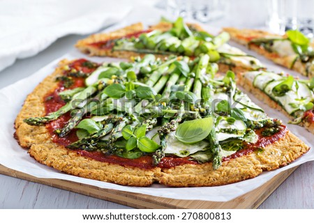 Cauliflower green pizza with spinach, zucchini and asparagus - stock photo