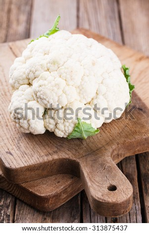 Cauliflower on wooden boards.selective focus - stock photo