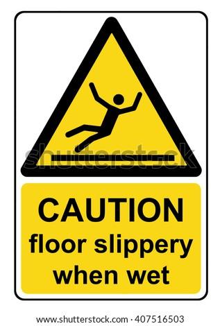 Caution floor slippery when wet yellow warning sign - stock photo