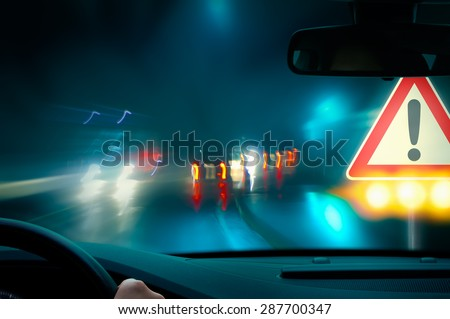 Caution - Night Driving - stock photo