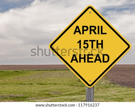 Caution Sign about Taxes Being Due On April 15th. - stock photo