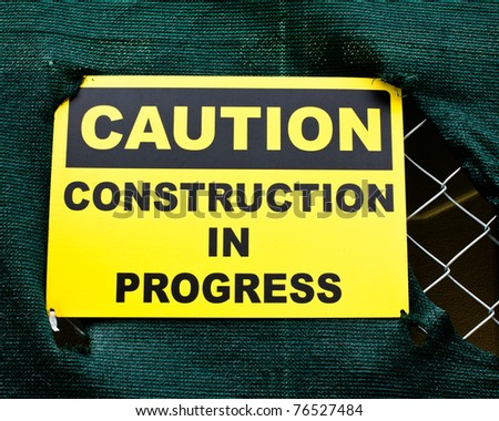 Caution sign at a construction site - stock photo