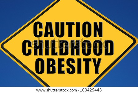 "Caution sign reading ""Caution Childhood Obesity"" - stock photo"