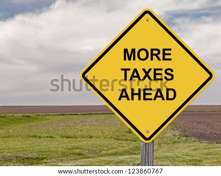 Caution Sign - Warning That More Taxes Are Ahead - stock photo