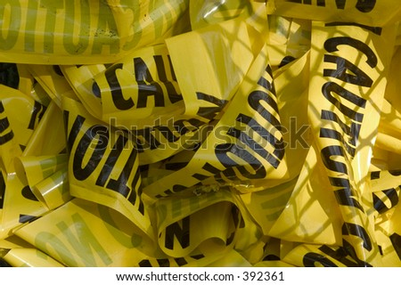 caution tape in trash can - stock photo