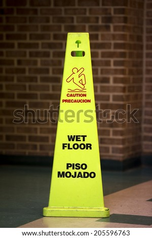 Caution Wet floor sign against a bathroom  - stock photo