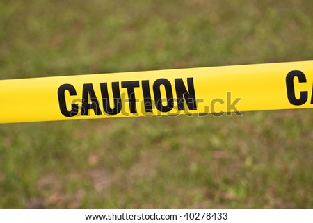 caution yellow tape - stock photo