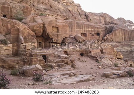 Cave dwellings in the Rose City of Petra, Jordan. The city of Petra was lost for over 1000 years but is now one of the new Seven Wonders of the World. - stock photo