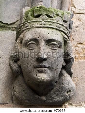 Caved head on ancient church in Birmingham, England - stock photo