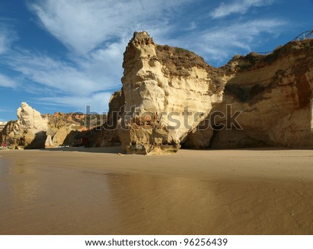Caves and colourful rock formations on the Algarve coast in Portugal - stock photo