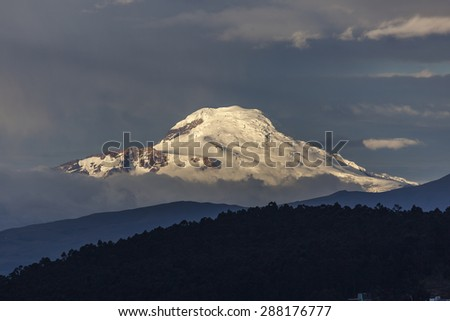 Cayambe volcano seen from Quito at sunset - stock photo