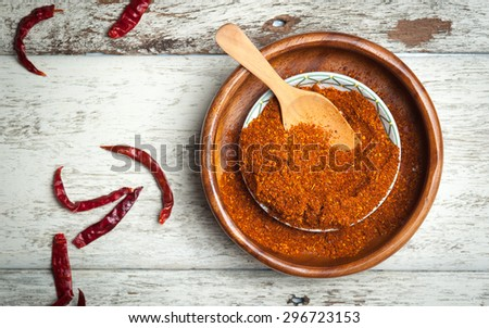 Cayenne pepper spice on wooden table - stock photo