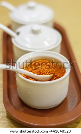 Cayenne pepper spice on wooden table (asian food) - stock photo