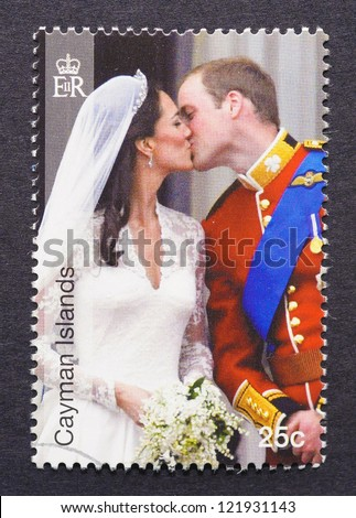 CAYMAN ISLANDS - CIRCA 2011: a postage stamp printed in Cayman Islands showing an image of royal wedding between Prince William and Kate Middleton, circa 2011. - stock photo