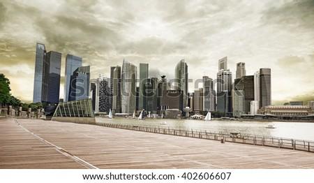 CBD of Singapore under a thundery sky - stock photo