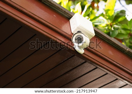 CCTV Camera on ceiling - stock photo