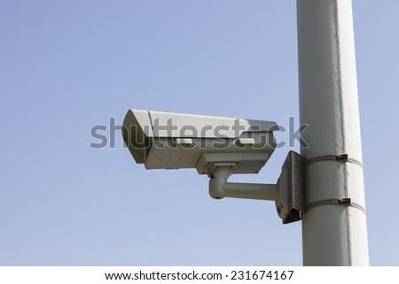 cctv camera on steel pole  - stock photo
