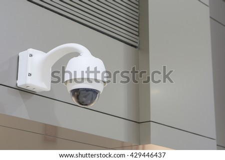 CCTV Camera Operating inside a airport or train station or department store,selective focus  - stock photo