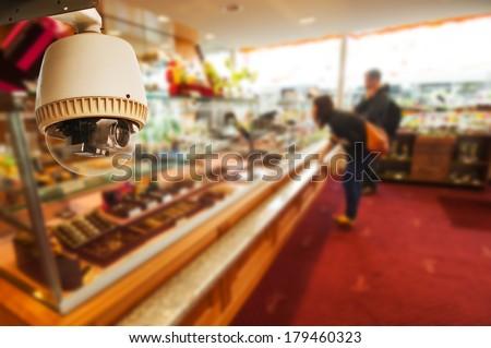 CCTV Camera Operating inside a shop - stock photo