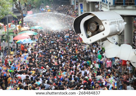 CCTV Camera Operating outside a people on songkran festival.Security camera detecting the movement of traffic.  - stock photo