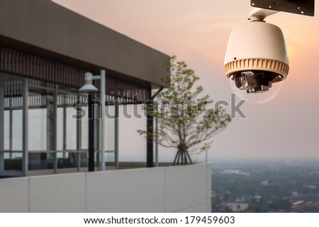 CCTV Camera Operating outside building - stock photo