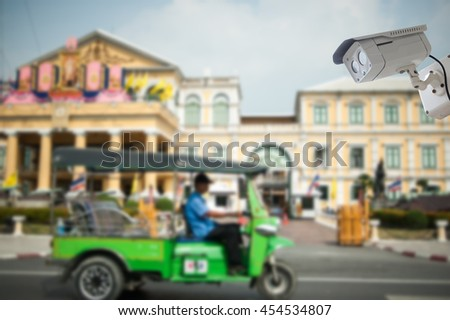 cctv camera with Ministry of Defence, Bangkok blur background - stock photo