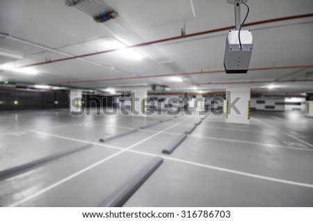 CCTV cameras in a car park building. - stock photo
