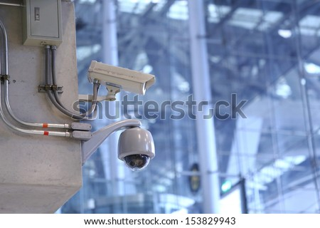 CCTV cameras in the airport. - stock photo