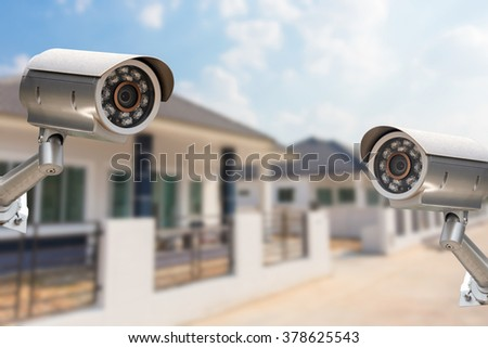 CCTV Home camera security operating at house. - stock photo