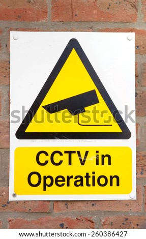 CCTV in operation sign on a brick wall background - stock photo
