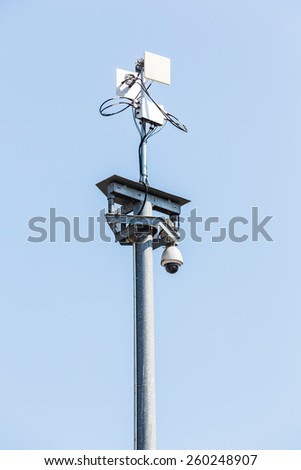 CCTV IP camera with wireless network on blue sky - stock photo