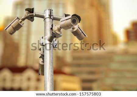 CCTV security camera in a big capital city - stock photo