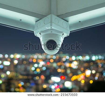 CCTV security camera in building with cityscape at twilight time Blurred Photo bokeh - stock photo