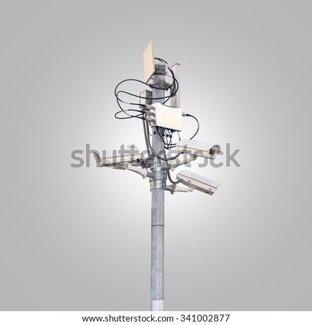 CCTV security camera on gray background - stock photo
