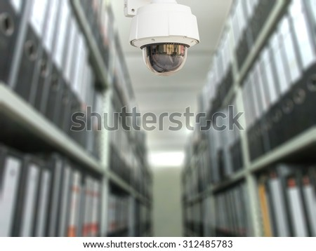 CCTV system security in document store room blur background. - stock photo
