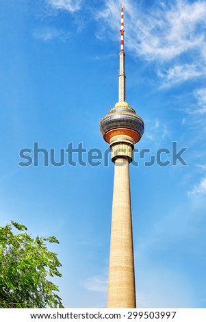 CCTV tower against a blue sky, in capital of China,Beijing. - stock photo