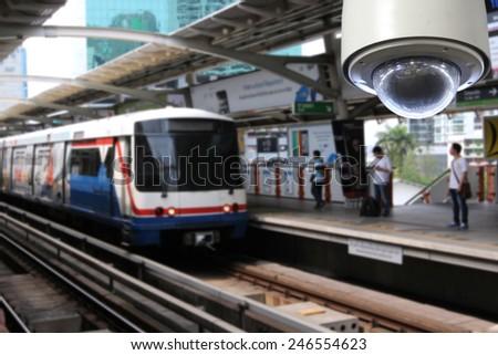 CCTV with blurred metro train platform - stock photo