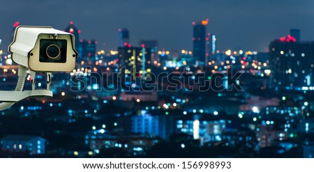 CCTV with Blurring City in background - stock photo
