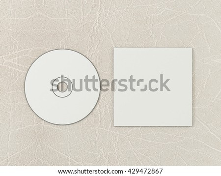 CD disc and carton packaging cover template mock up. Pack case of cardboard CD drive. With white blank for branding design or text. Isolated on leather background. High resolution 3d illustration. - stock photo