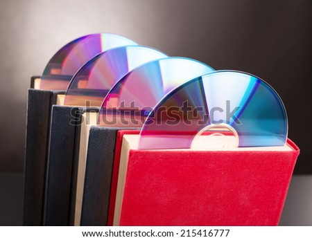 Cd disks are sticks out from red book - stock photo