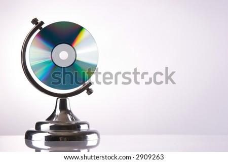 CD in globe holder - stock photo