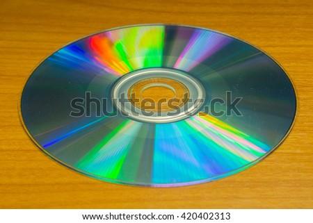 CD on Wood background - stock photo