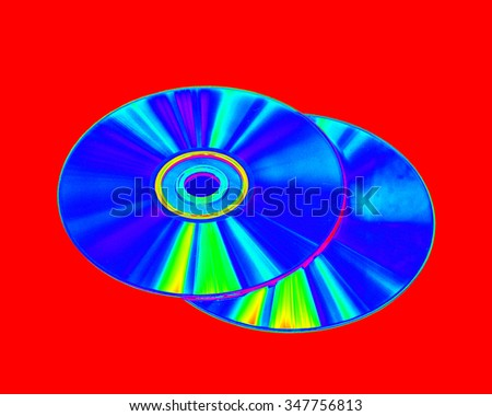 CD-ROM and DVD-ROM drive, on a red background color of the gradient image - stock photo