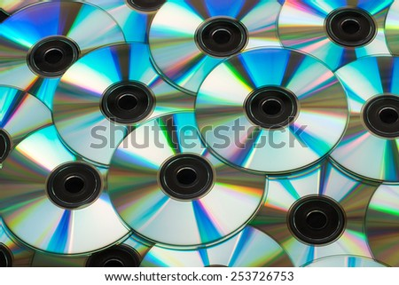 CDs or DVDs background - stock photo