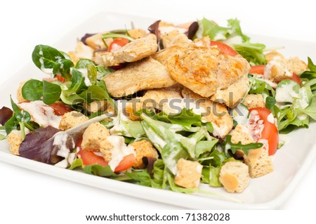 Ceasar salad on a plate isolated on white - stock photo