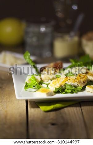 ceasar salad on rustic wood  - stock photo