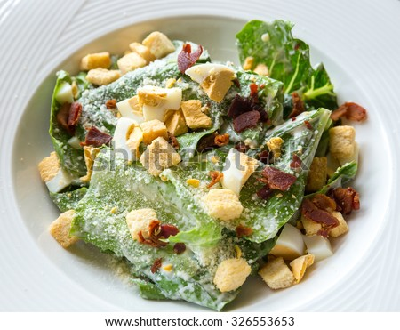 Ceasar Salad with bacon bit - stock photo